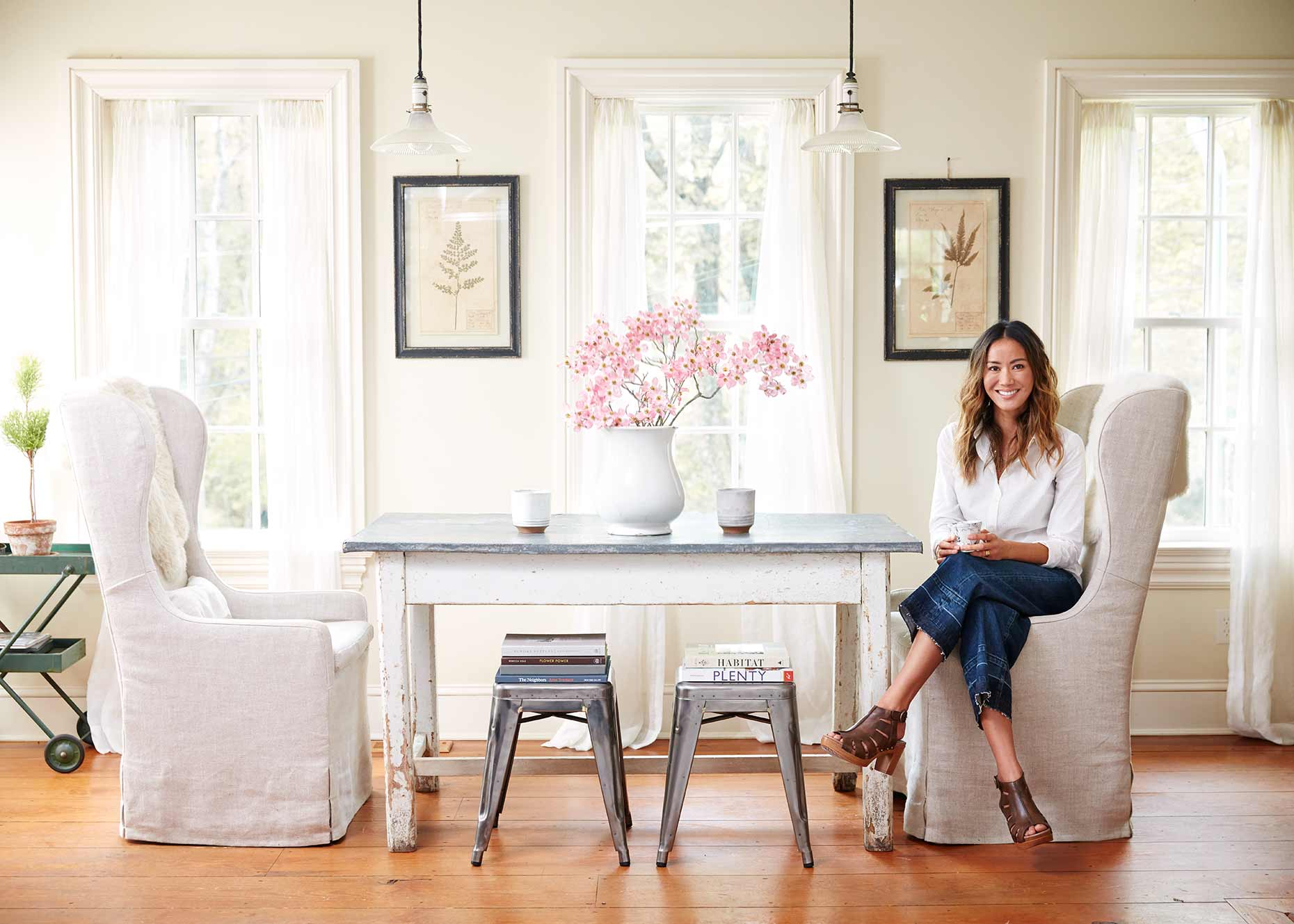 Homeowner seated at her light and airy farm style dining.