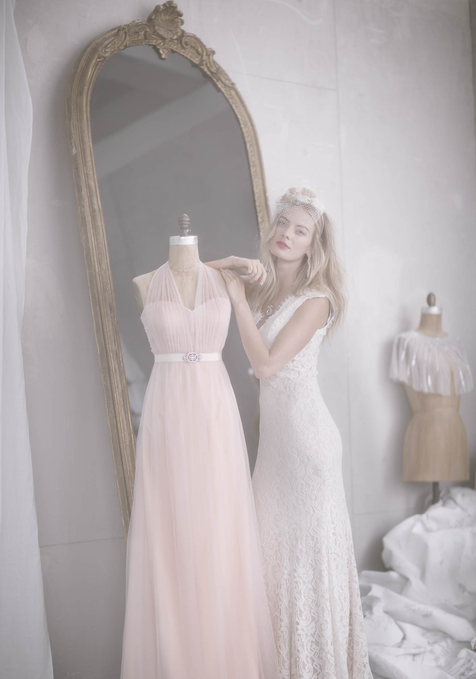 Bridal beauty photograph for BHLDN of model leaning on a dress form
