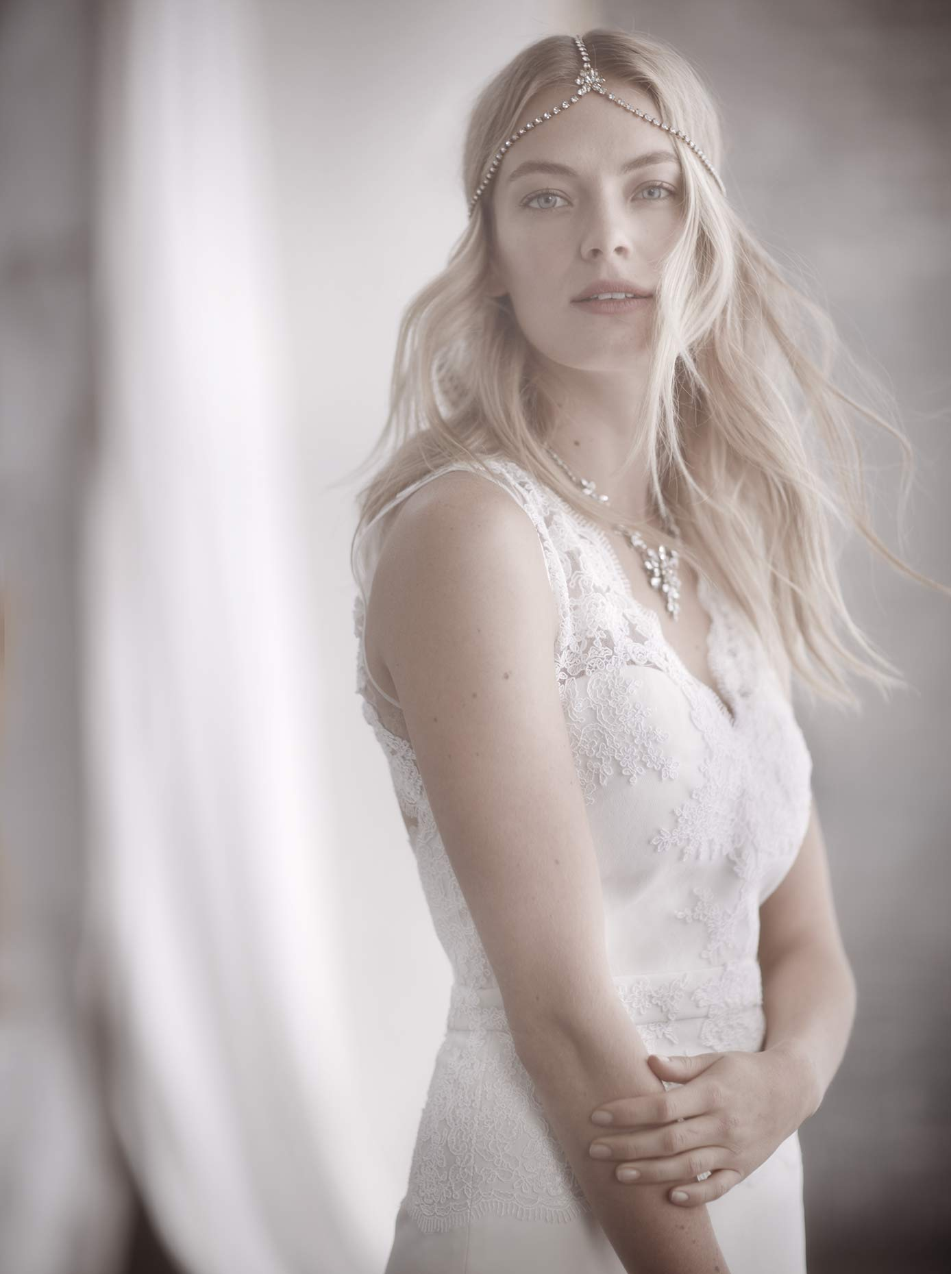 Bridal beauty photograph for BHLDN featuring a model in a white dress