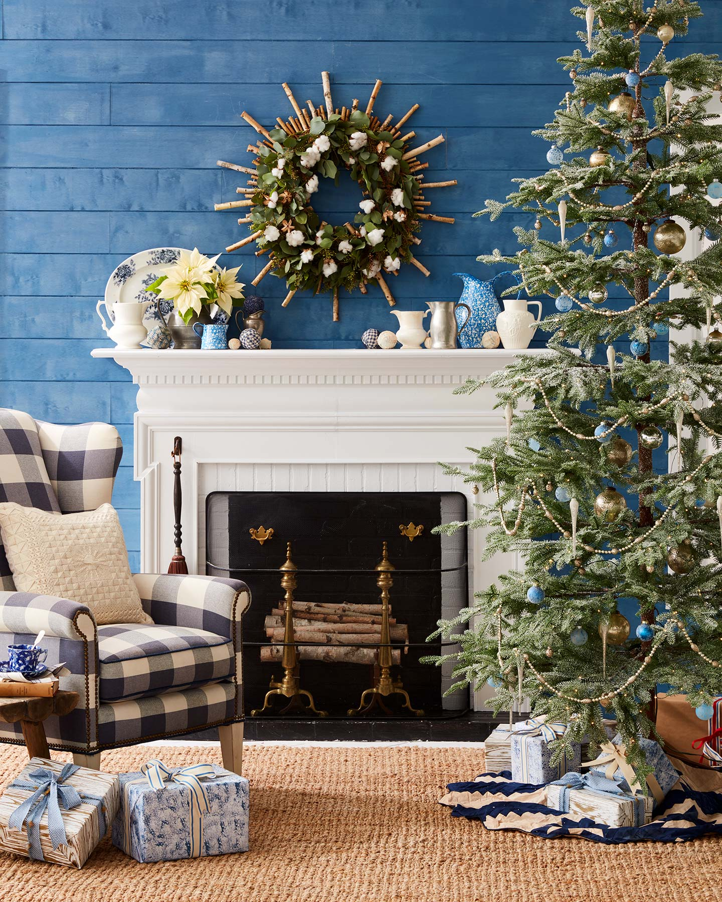 Holiday room scene with Christmas tree and mantle.