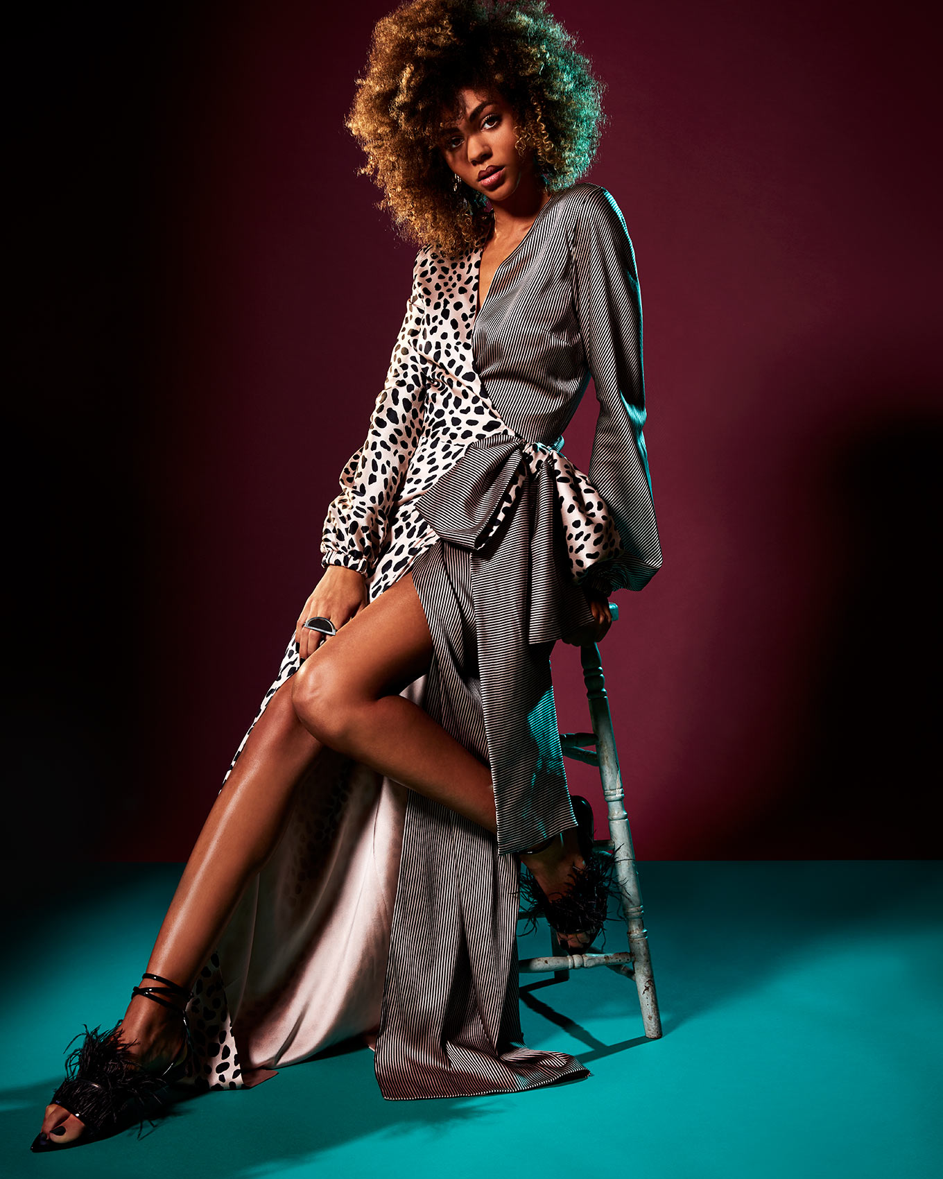 Fashion photography featuring a model using studio lighting and gels.