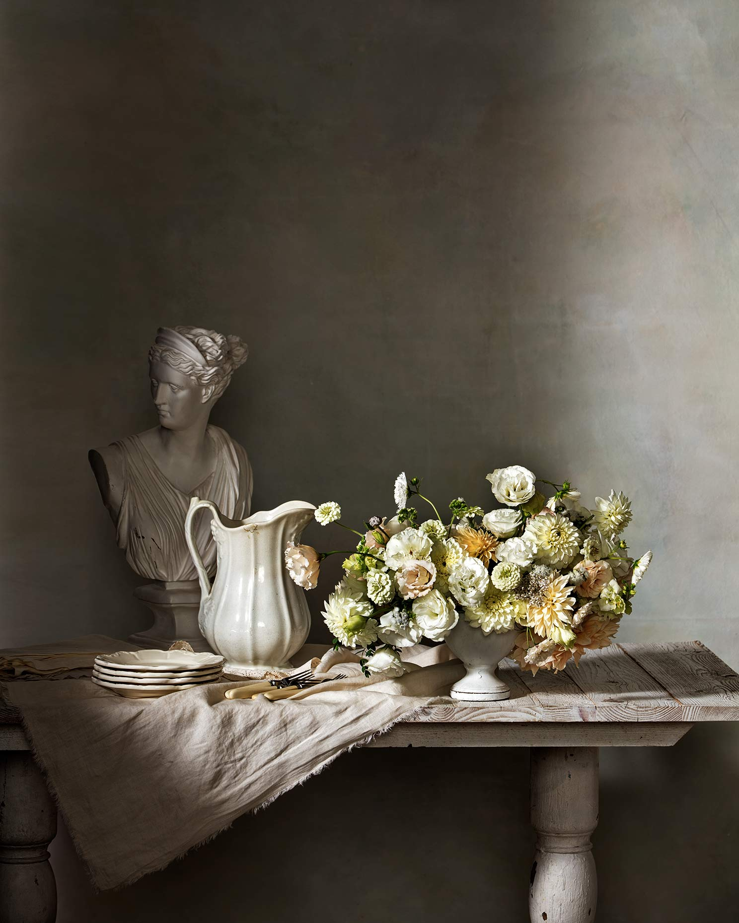 flowers and bust on a table.