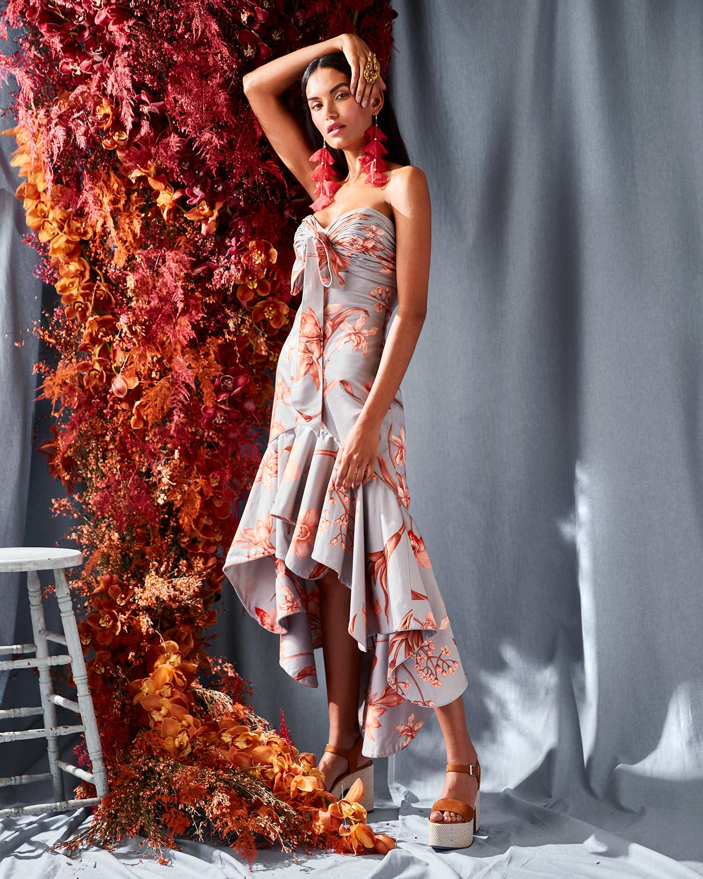Fashion photography featuring a large floral arrangement and model.