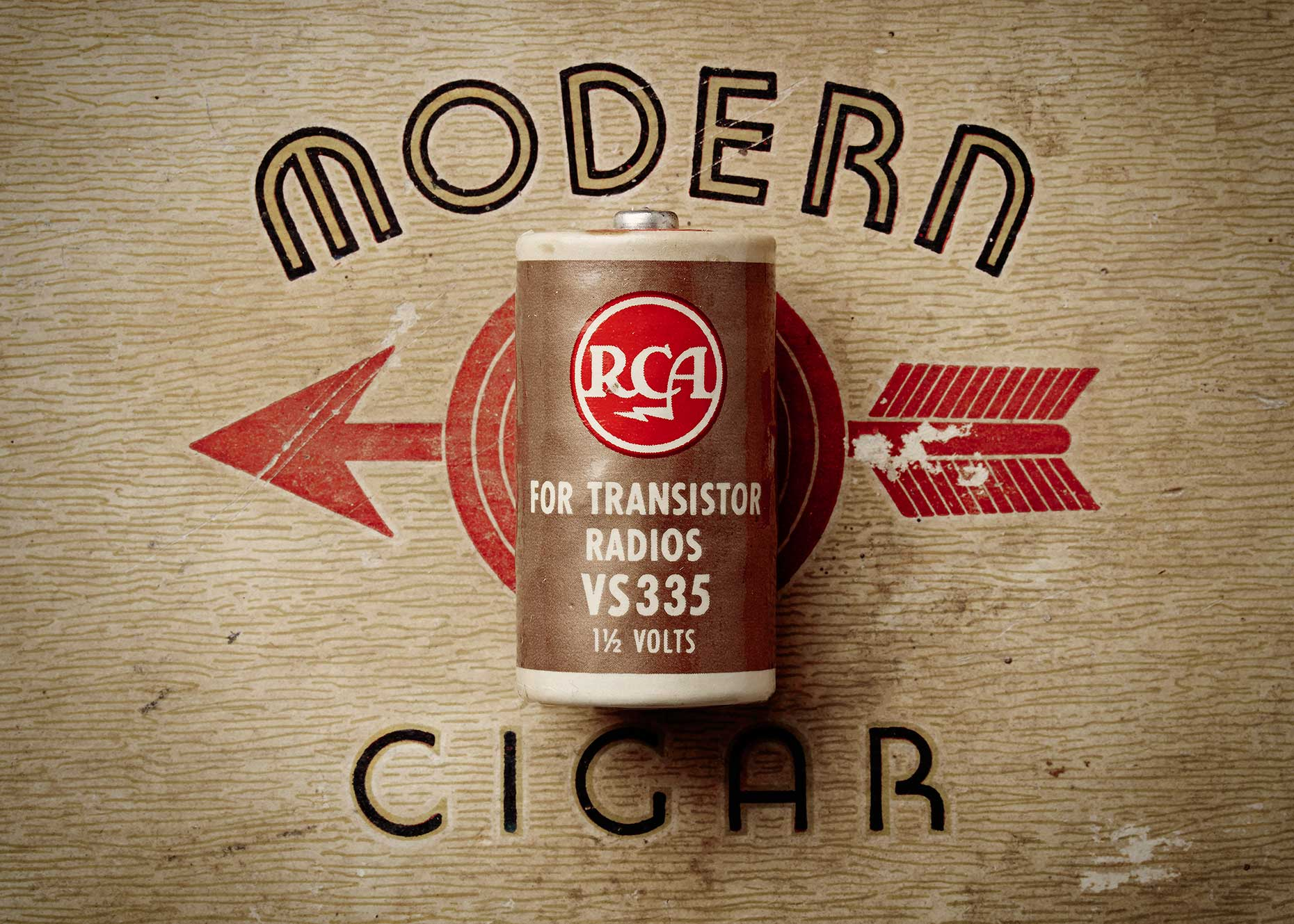 Old RCA battery on a vintage cigar box