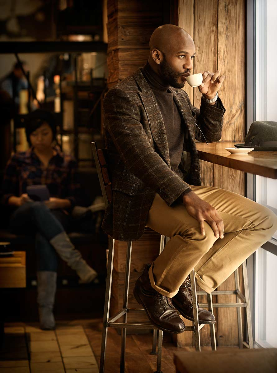 Stylish man sips espresso in an urban coffee shop