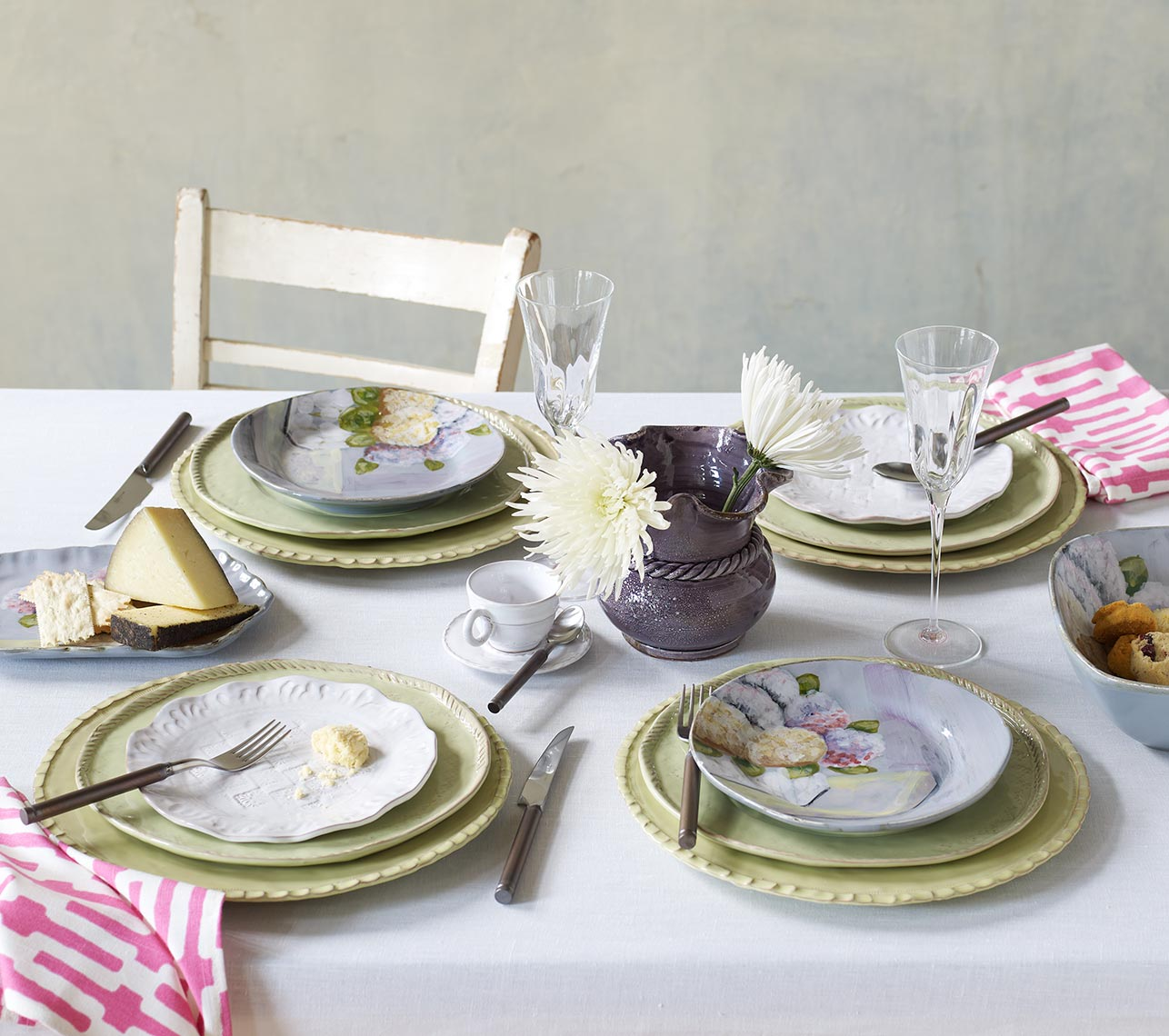 table scene with plates and flowers