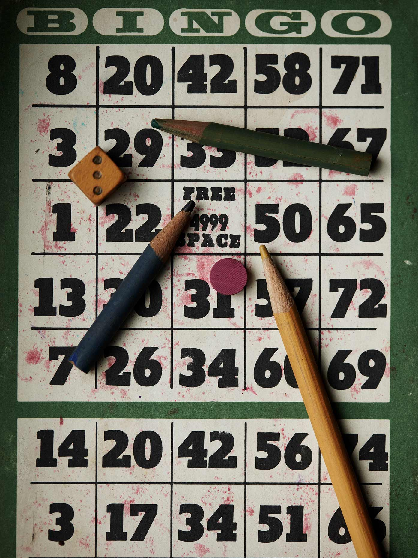 Bingo card and colored pencils.