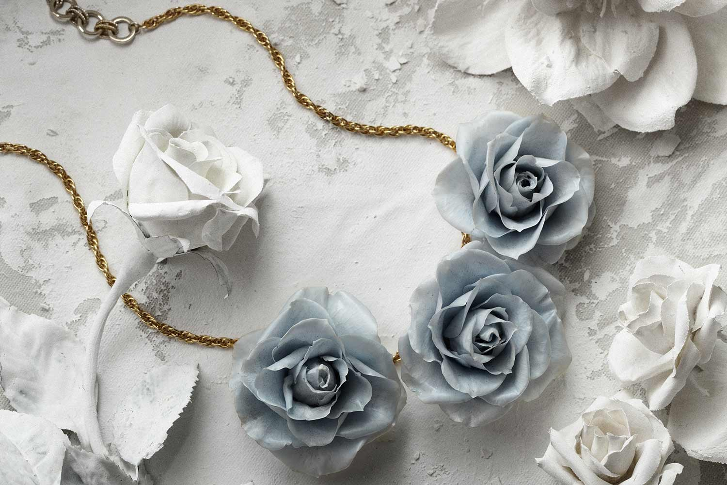 Blue rose necklace jewelry photograph.