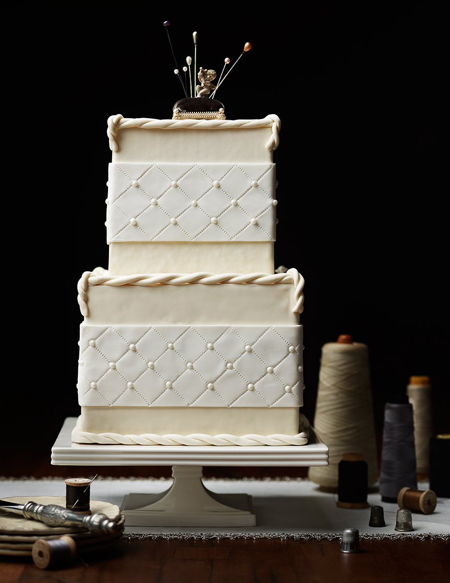 Wedding cake with vintage sewing accessories.