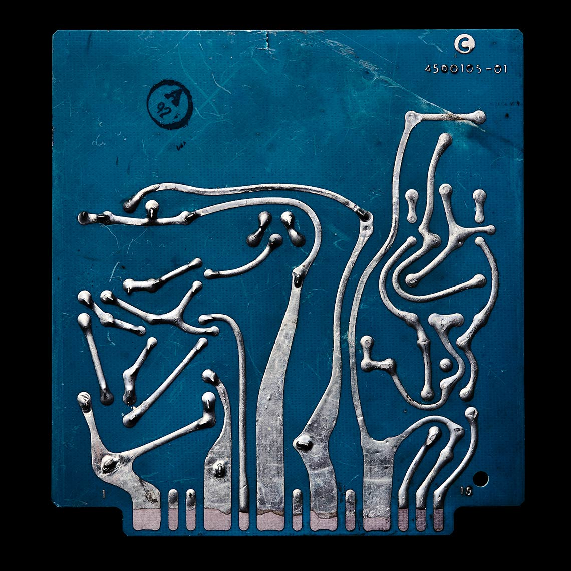 Macro photography of a blue antique circuit board