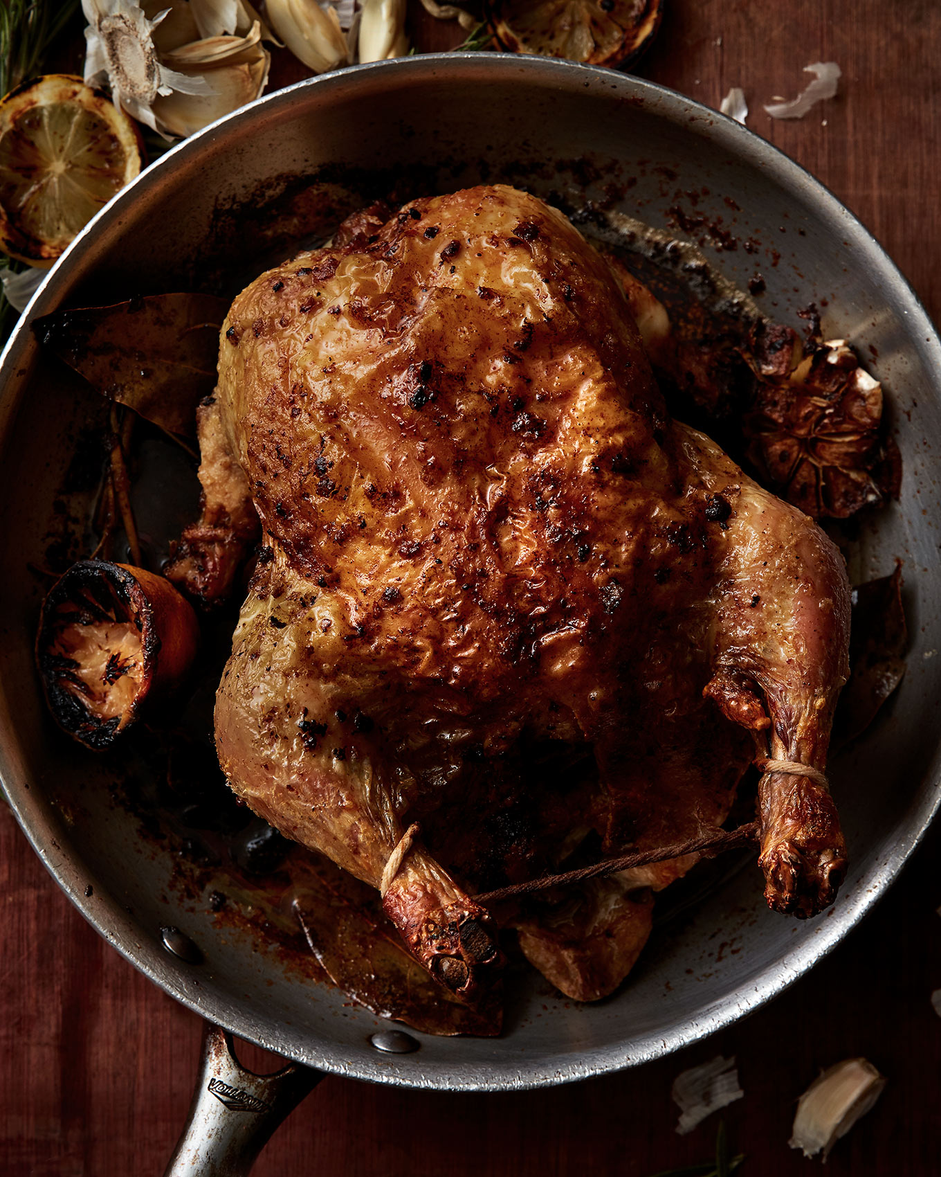 roast whole chicken in a pan food photograph