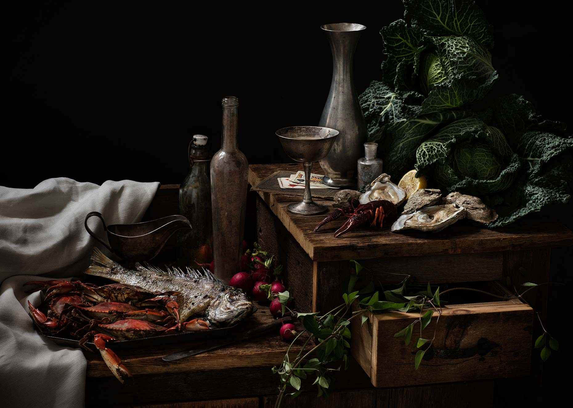 Dutch masters style still life photograph featuring seafood and vintage props.