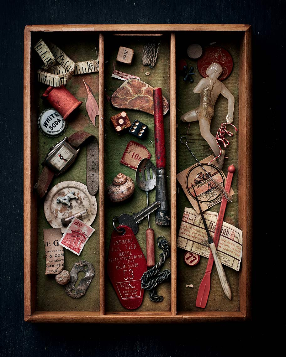 Photograph of a curated junk drawer with vintage items.