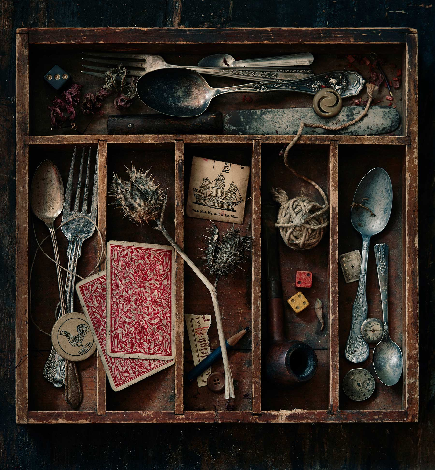 Photo of a curated junk drawer with vintage items.