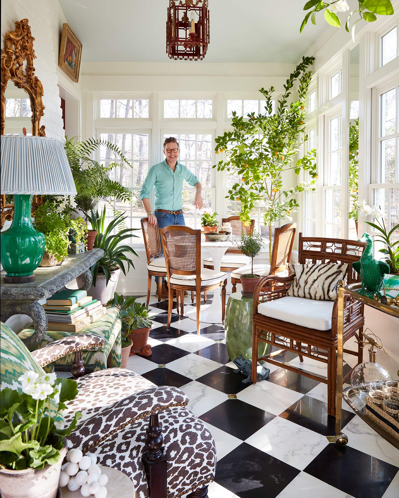 portrait of designer Eddie Ross in his sunny garden room