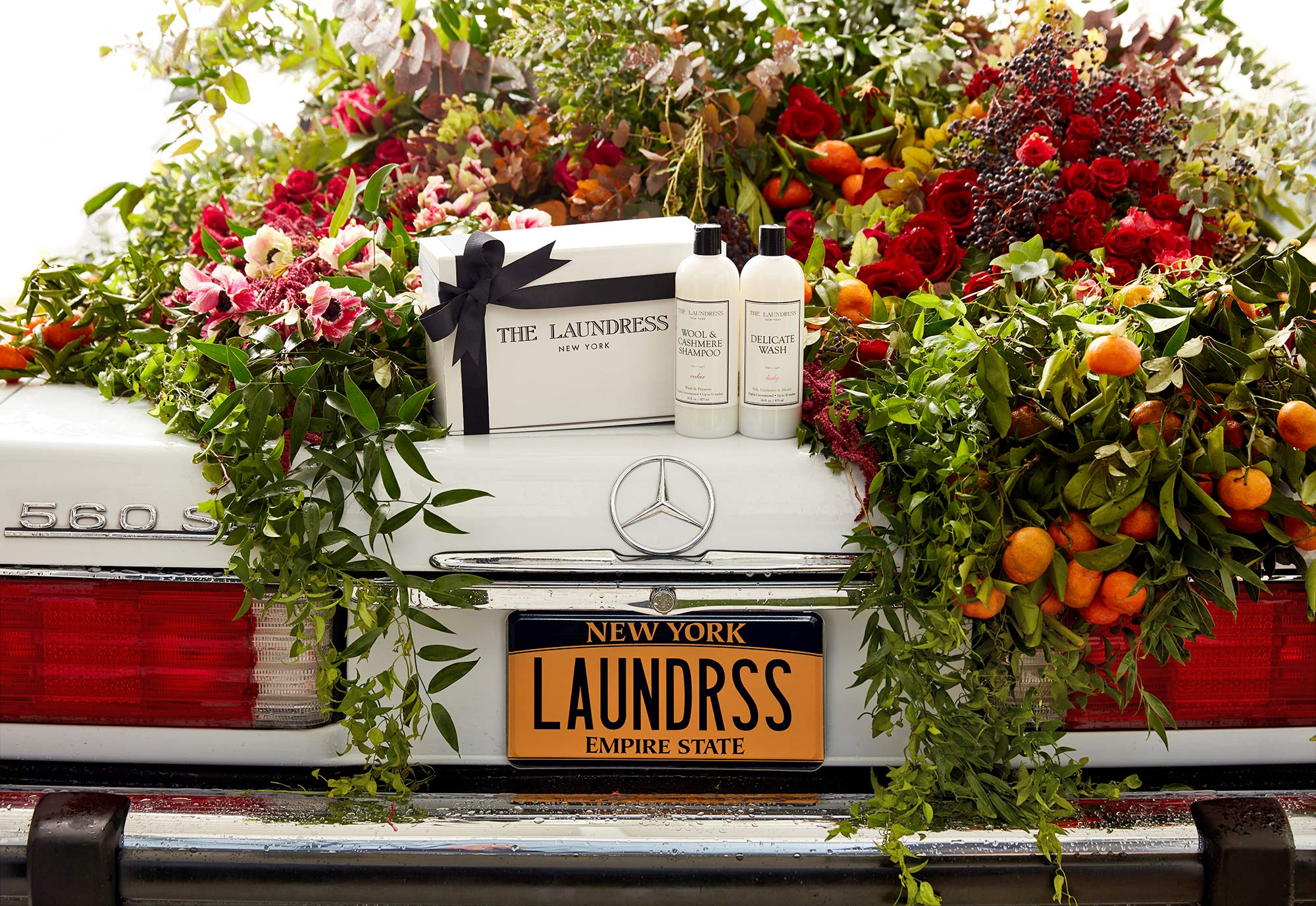 Laundress product on back of car with flowers