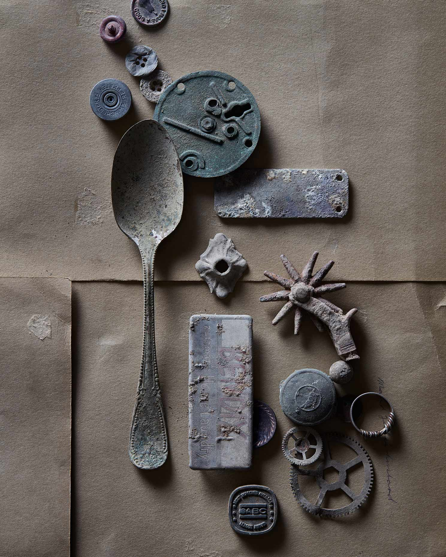 Found objects from metal detector collection on cut paper