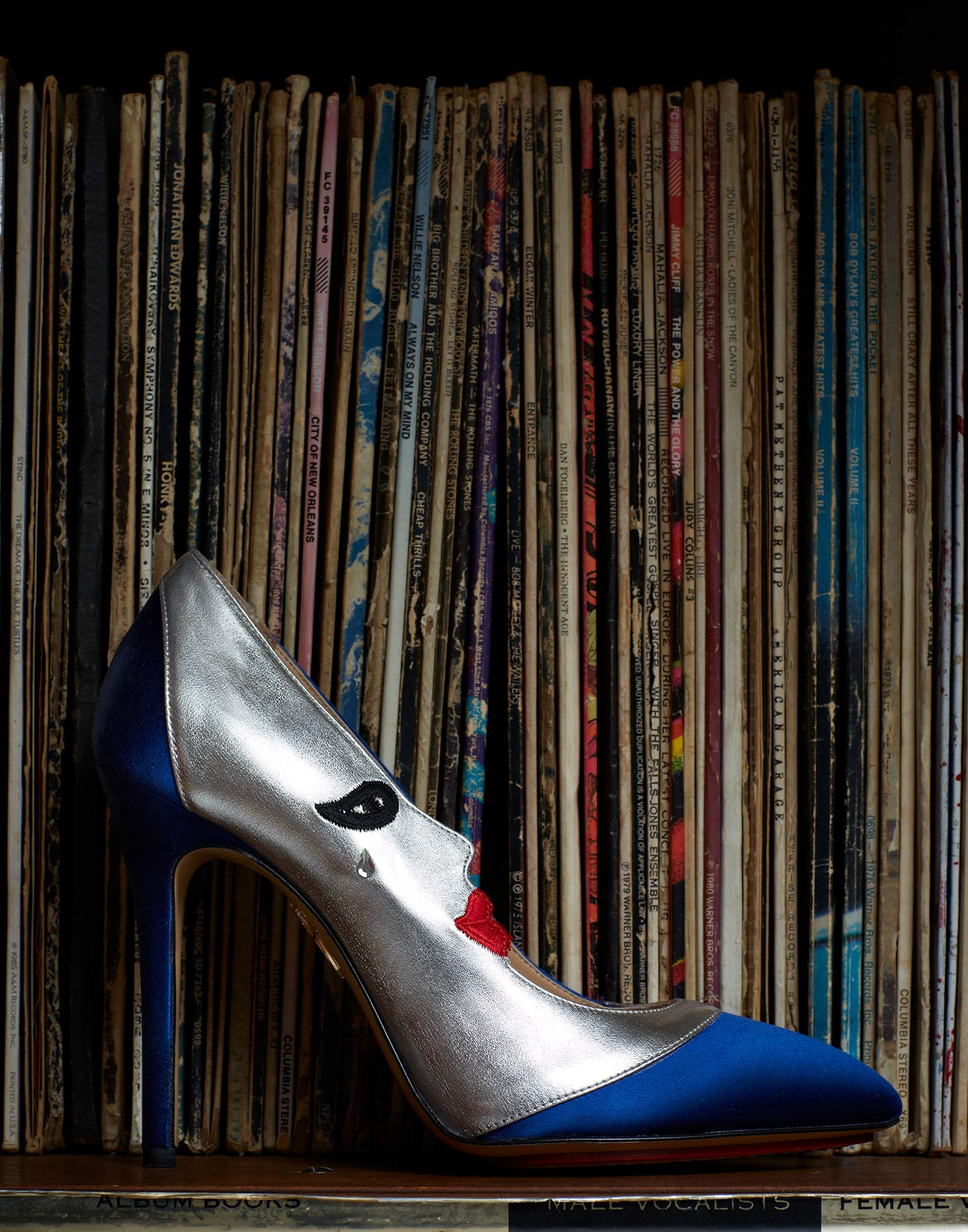 Prada heels and old records
