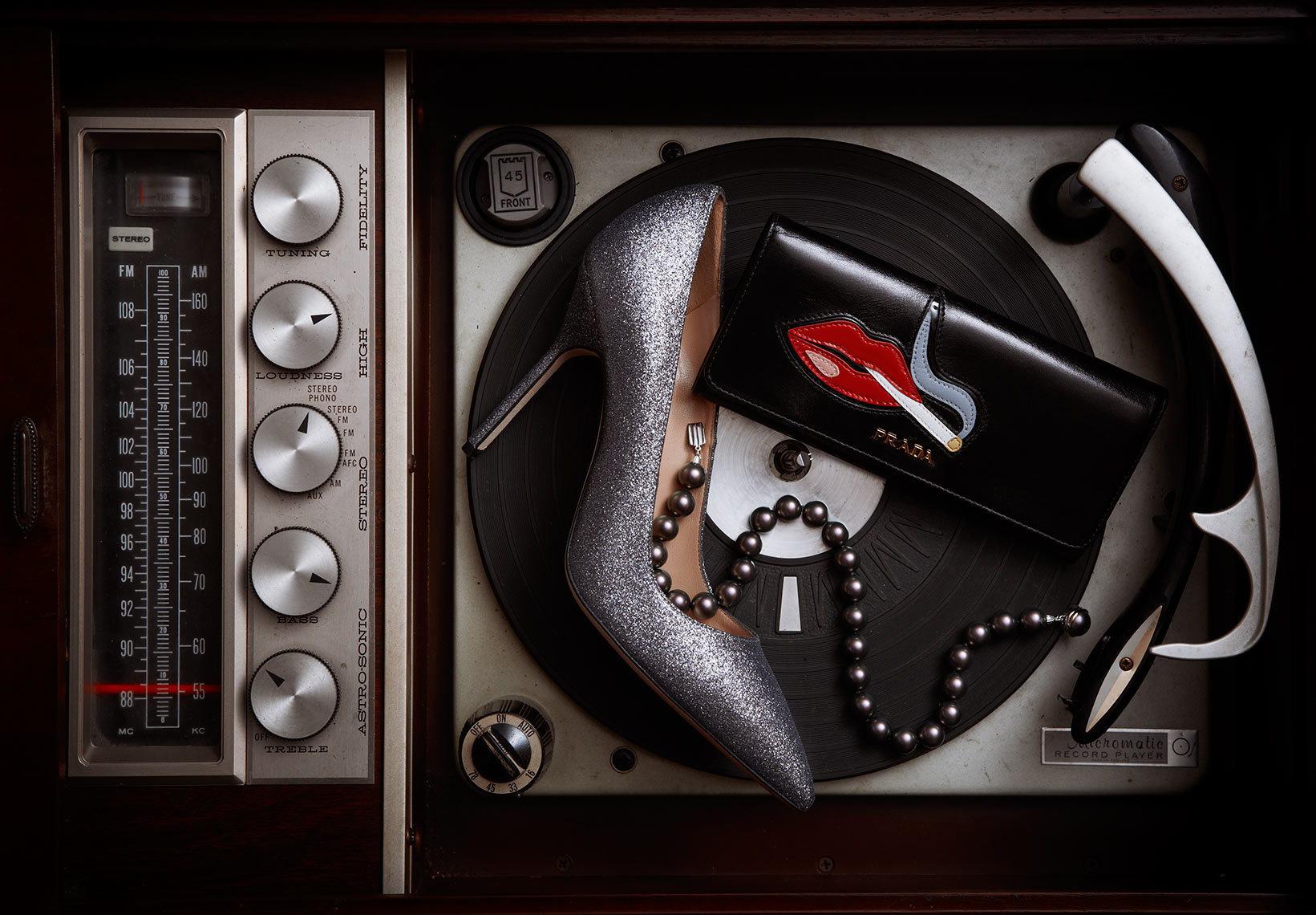 Still life photograph on old record player featuring Prada