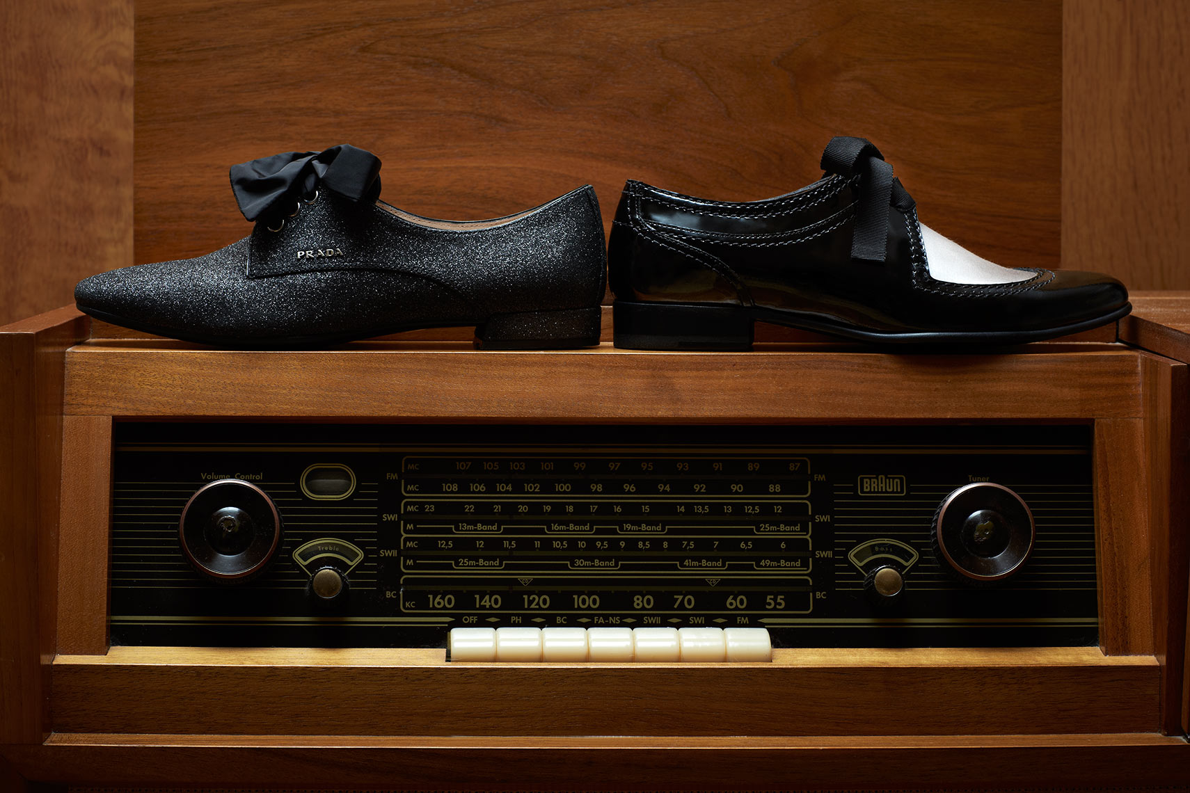 Fashion still life showing shoes on a vintage antique record player.