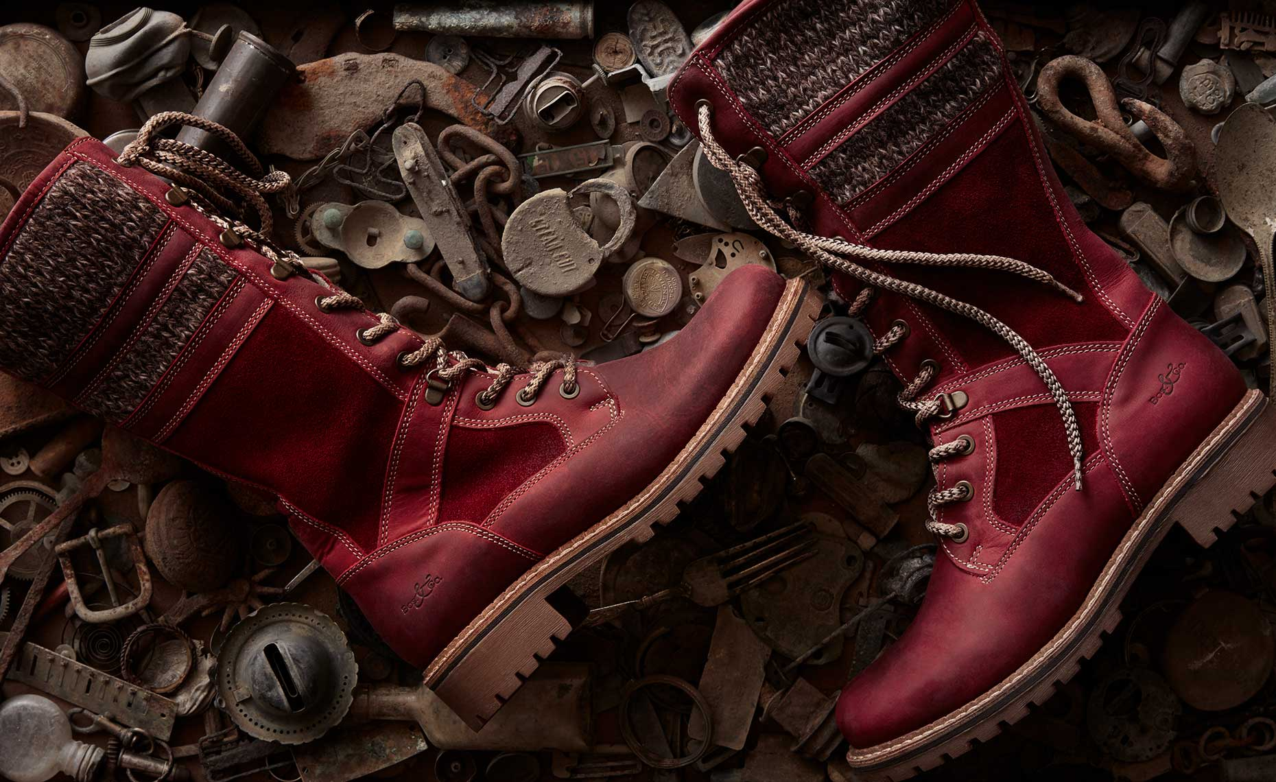 Red boots on metal objects.