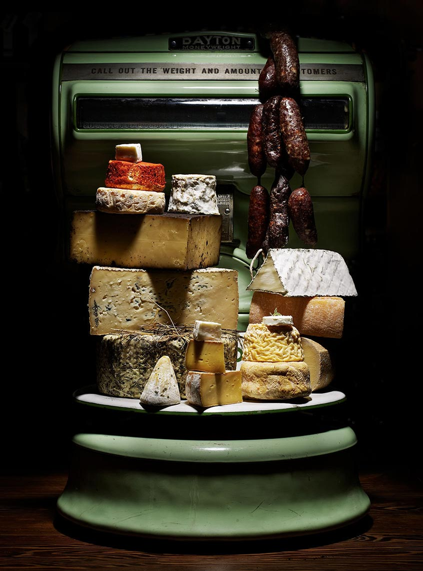 meat and cheese on a vintage scale.