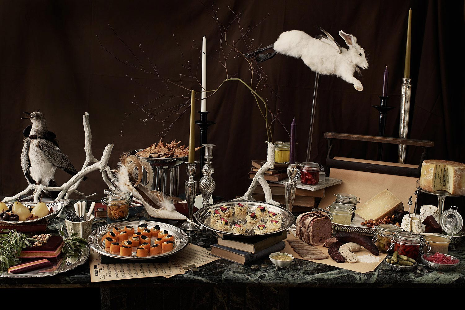 Eclectic dinner party table with taxidermy rabbit