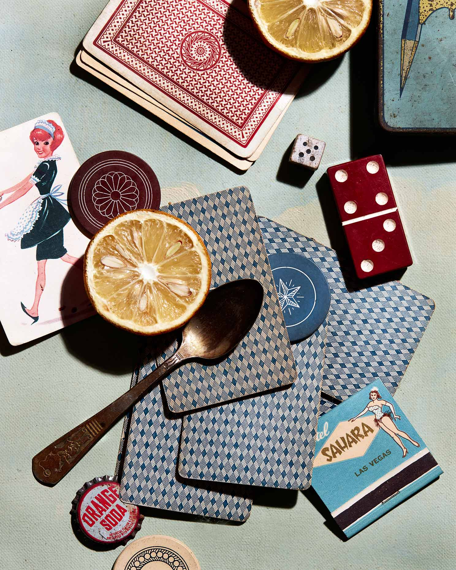 Still life photograph with cards, dice and other gaming items