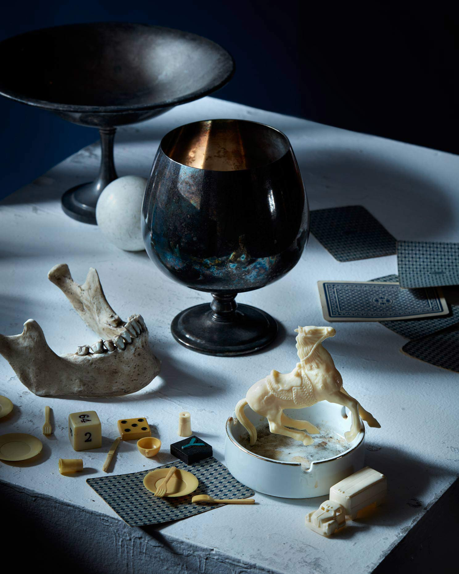 Artistic dark still life photograph of various vintage objects.